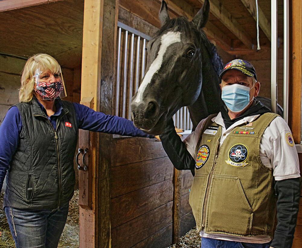 Cmdr Rick whispering to Horses at Beaming